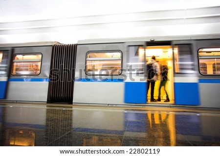 Move train on underground station - stock photo