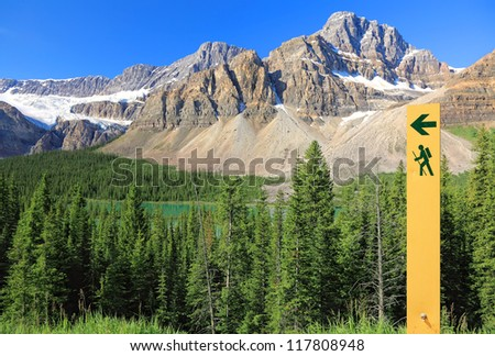 Movement directional marker in nature reserve. Rocky Mountains, Canada - stock photo