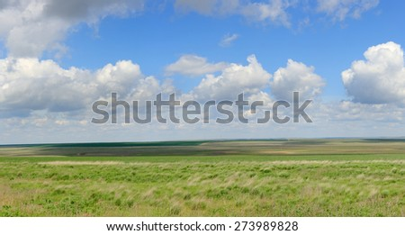 Movement of clouds in the steppe, the Rostov region, Russia. - stock photo