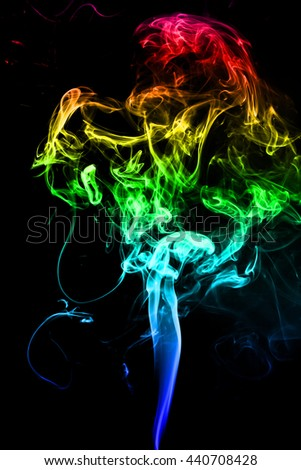 movement of color smoke, Abstract colorful smoke on black background, smoke background, colorful ink background, Yellow adn Violet and Orange and Blue smoke, beautiful color smoke - stock photo