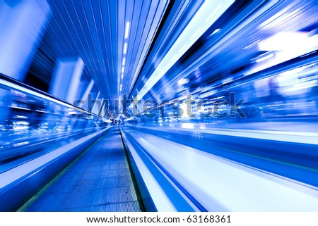 movement of diminishing hallway escalator - stock photo