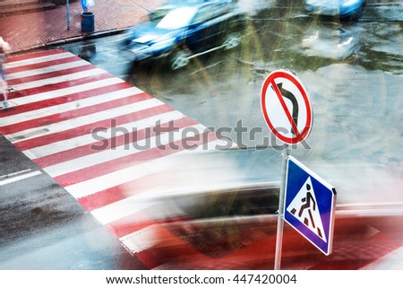movement of people and cars on the pedestrian crossing the intersection, blurred motion - stock photo