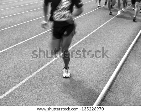 Movement of people in track and field - stock photo