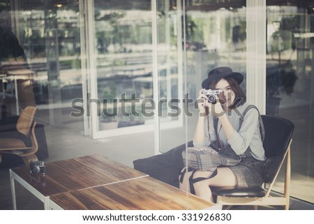 movement of photographer. portrait young woman in vintage style - stock photo