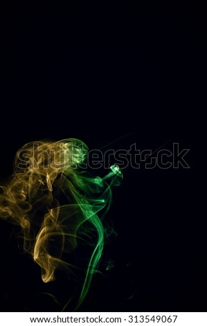Movement of smoke, Abstract red and green and brown smoke on black background, smoke background,red and green and brown ink background, red ,green, brown