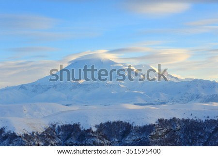 Movement of the clouds on the mountains Elbrus, Northern Caucasus, Russia. - stock photo