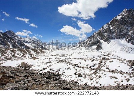 Movement of the clouds on the mountains Everest, Gyazumba Glacier, Himalayas, Nepal - stock photo