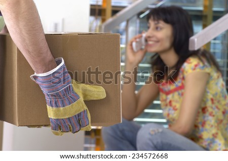 Mover and Woman on Cell Phone - stock photo
