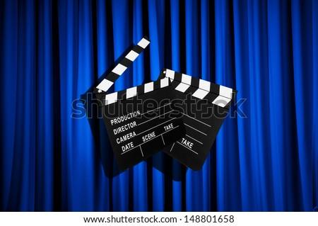 Movie clapper board against curtain - stock photo