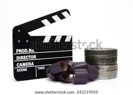 Movie clapper board and 35mm film on white background - stock photo