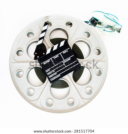 Movie clapper board on  vintage big 35mm film big reel for cinema projector on white background - stock photo