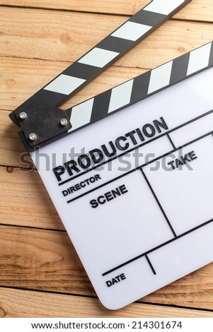 movie clapper board on wood