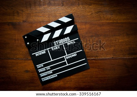 Movie clapper board on wood aged table, movie symbol