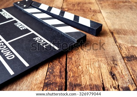 Movie clapper on wood table - stock photo