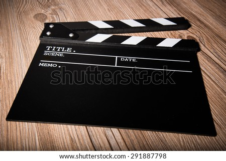 movie clapper on wooden background - stock photo