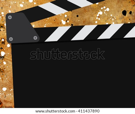 Movie clapperboard on a grunge background with scratches