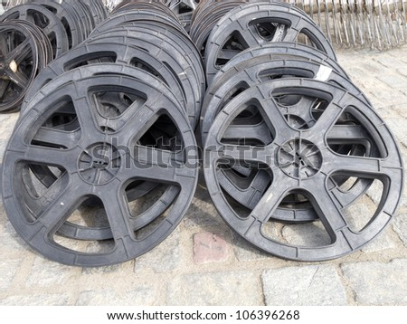 movie film rolls laying in the floor - stock photo