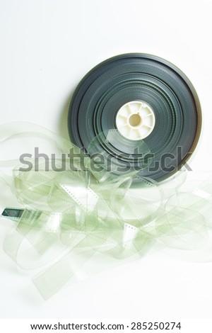 Movie 35 mm film reel on white background vintage color effect vertical frame - stock photo