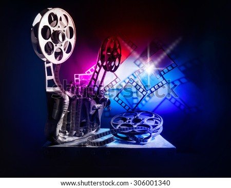 Movie projector with a color film - stock photo
