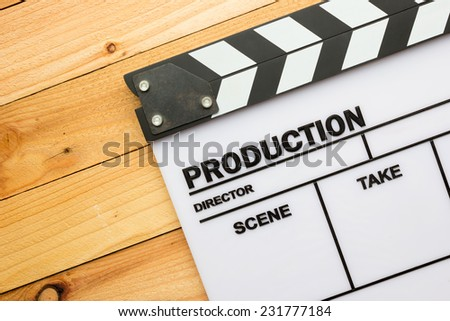 Movie slate film on wooden table - stock photo