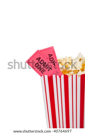 Movie Theater popcorn container with two movie tickets on a white background with copy space - stock photo
