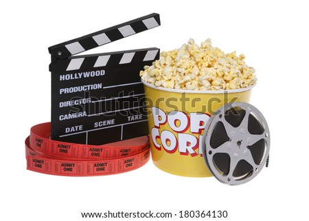 movie theater still life with popcorn, movie reel, tickets, and cut board on white