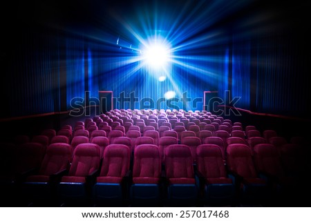 Movie Theater with empty seats and projector / High contrast image - stock photo