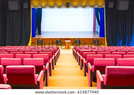 Movie theatre interior. screen, chairs and curtain.