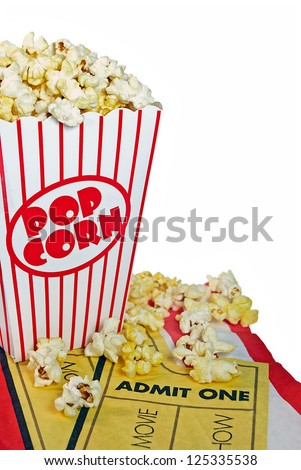movie tickets on napkin with buttery popcorn in a striped box - stock photo