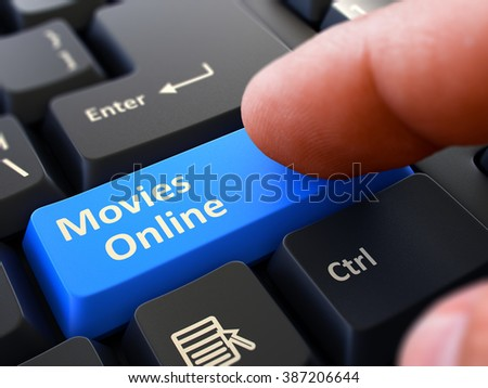 Movies Online Person Click on Blue Keyboard Button with Text Movies Online. Selective Focus. Closeup View. 3D Render. - stock photo