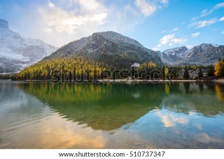 Moving autumn landscape with sunrise over the lake on Fanes-Sennes-Braies natural park. Dolomites, Alps, South Tyrol, Italy, Europe. (mental vacation, holiday, harmony, honeymoon - concept)
