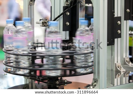 Moving Bottles on Labelling machine for Industry - stock photo