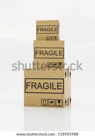 moving box with a fragile sticker on a white background - stock photo