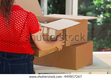 Moving box. Women carrying box