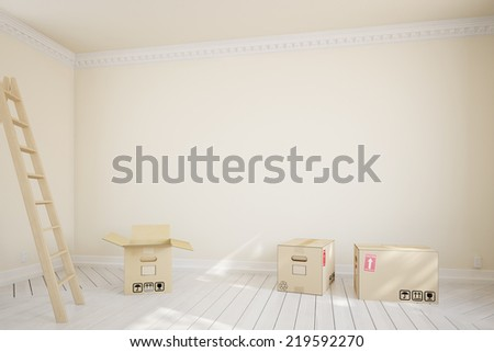 Moving boxes and ladder in empty room during relocation - stock photo