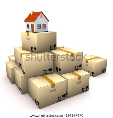 Moving boxes with small house on the white background. - stock photo
