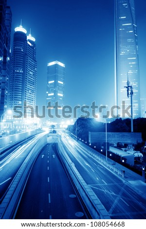 moving car with blur light through city at night - stock photo