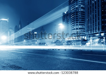 moving car with blur light through city at night