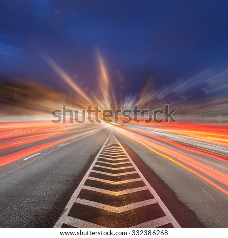 Moving car with blur light through city at night. - stock photo