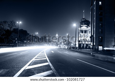 moving car with blur light through city at night in shanghai china
