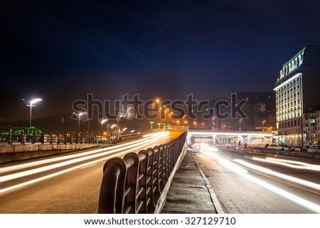 moving car with blur light through city at night. Kiev city, Ukraine. - stock photo