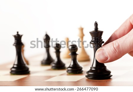 moving chess pieces on a chessboard - stock photo