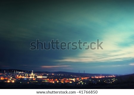 Moving clouds over the city - stock photo