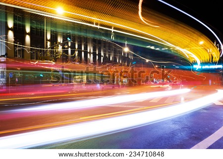 Moving colorful trace lights from bus through the crossroad in Luxembourg - stock photo