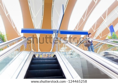 moving escalator in airport