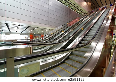 Moving escalator in blurred motion - stock photo