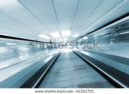 moving escalator in business center - stock photo