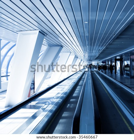 moving escalator in square composition