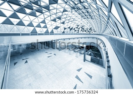 Moving escalator in the business center - stock photo