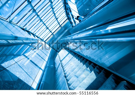Moving escalator in the metro station - stock photo